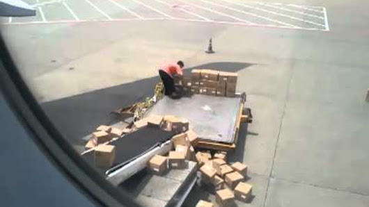 China Airport Worker Tenderly Loads Luggage By Chucking It