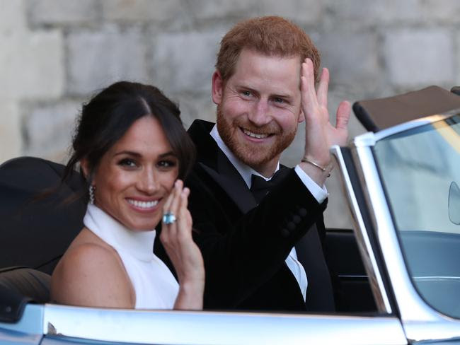 The newly married Duke and Duchess of Sussex, Meghan Markle and Prince Harry, leaves Windsor Cast   le after their wedding to attend the evening reception.