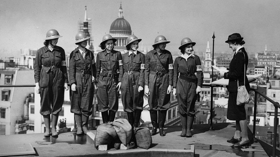 Women fire guards practising at the Bank of England, 1942