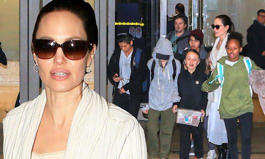 Angelina Jolie and her six children arrive back in Los Angeles