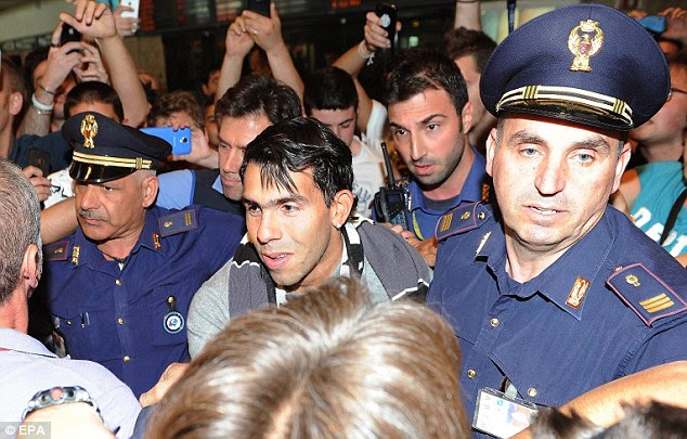 New start: Carlos Tevez arriving at Malpensa airport in Milan as he completes his move to Juventus