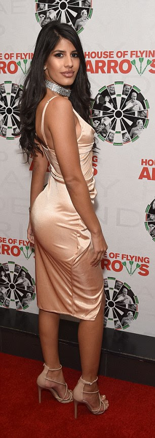 Stunner: The former TOWIE star, 26, turned heads in a slinky minidress that accentuated her ample assets with a very plunging neckline