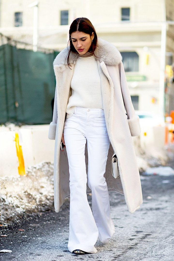 Le Fashion Blog Street Style Fashion Week Neutrals Long Shearling Coat Ribbed Sweater White Flared Jeans Via Harpers Bazaar