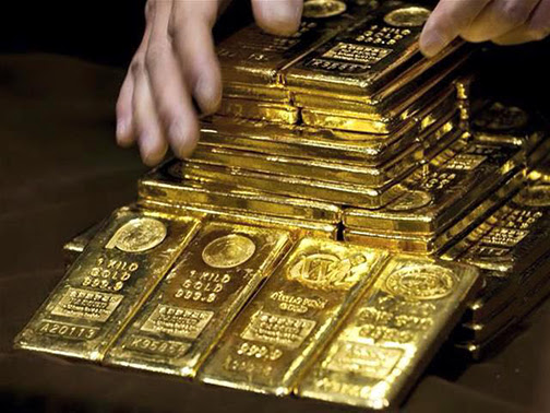 [Photo of gold bars]