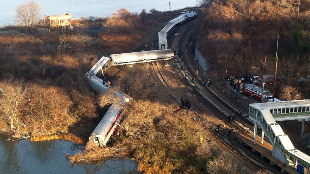PHOTO: Cars from a Metro-North passenger train are scattered after the train derailed in the Bronx neighborhood of New York, Sunday, Dec. 1, 2013.