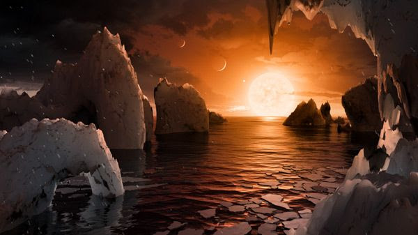 An artist's concept of how the surface of TRAPPIST-1f might look like...with two other planets in the TRAPPIST-1 star system visible in the sky.