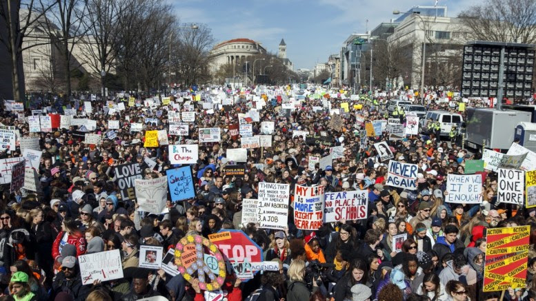 File Photo: Participants protest on Pennsylvania Avenue prior to the March For Our Lives in Washington, DC, USA, 24 March 2018. March For Our Lives was organized in response to the 14 February shooting at Marjory Stoneman Douglas High School in Parkland, Florida. The student activists demand that their lives and safety become a priority, and an end to gun violence and mass shootings in schools. EPA, SHAWN THEW