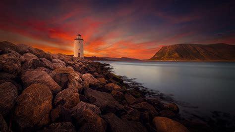 wallpaper lighthouse twilight sunset rocky shore  world  wallpaper  iphone