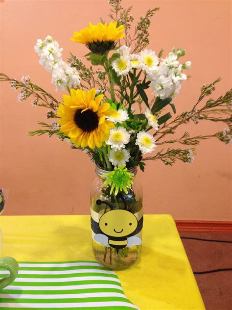 Mason jar flower centerpieces for a mommy to bee themed