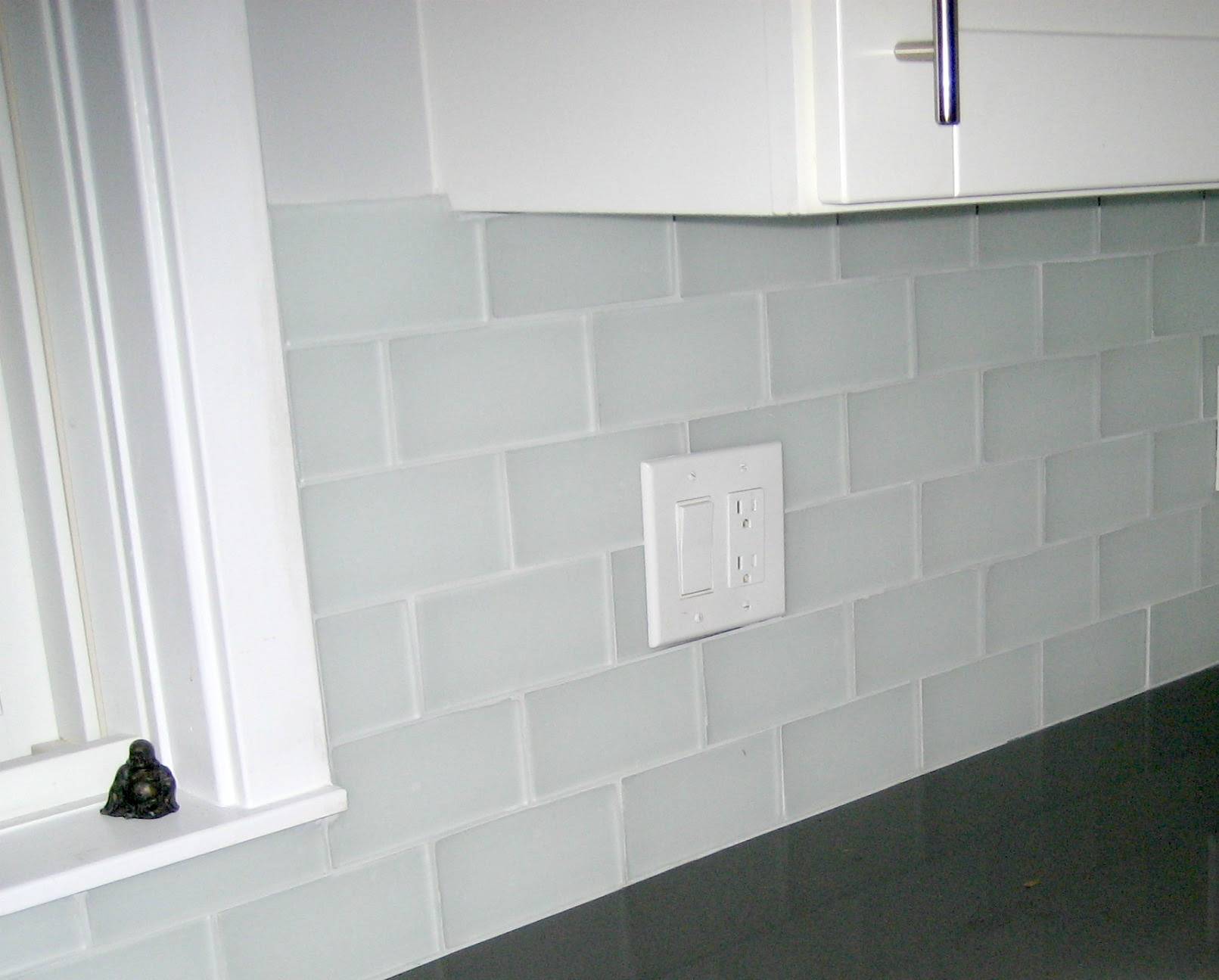 clear glass subway tile backsplash