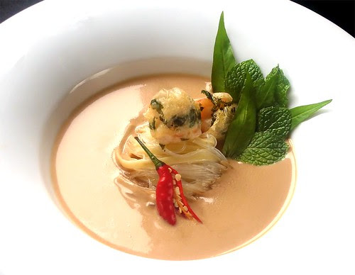 Fragrant Almond Laksa with noodles, fresh herbs and Oriental garden crispy prawns