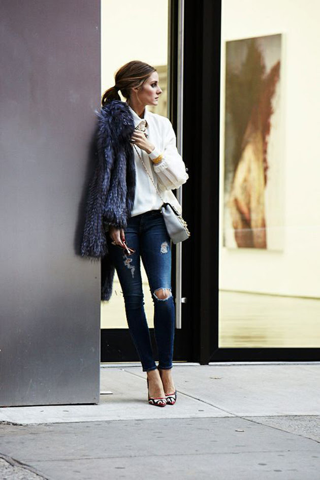 olivia palermo wearing white blouse, ripped jeans and leopard shoes and a great fur coat