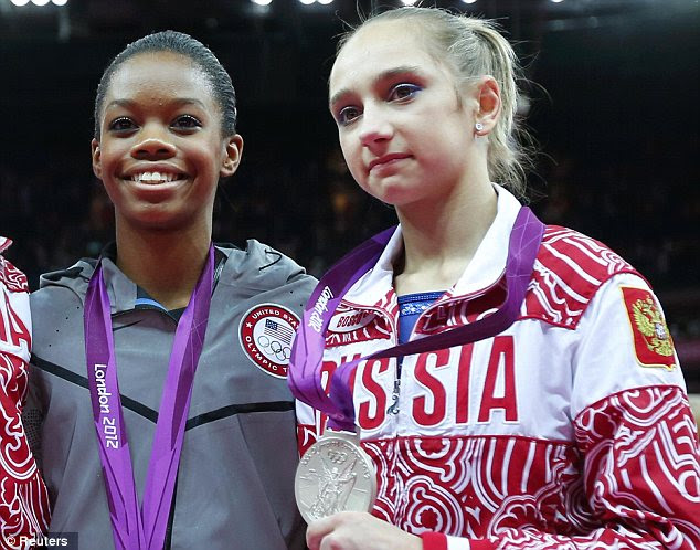Happy and sad: Even next to superstar U.S. gymnast Gabby Douglas, Victoria Komova of Russia couldn't muster a smile