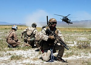 """U.S. Air Force pararescuemen and a simulated """"..."""