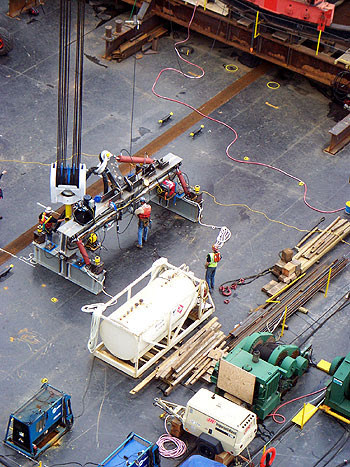 Workers get the deck lifter ready