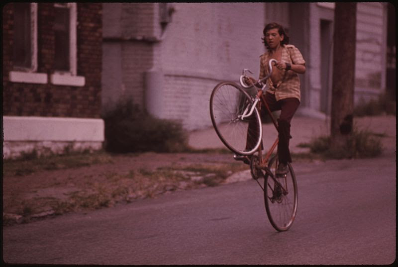 File:LOOK, MA, ONE WHEEL. BILLY WATKINS OF MULKY SQUARE CAN RIDE LIKE THIS FOR A WHOLE BLOCK, HAS EVEN OFFERED TO TEACH... - NARA - 553515.jpg