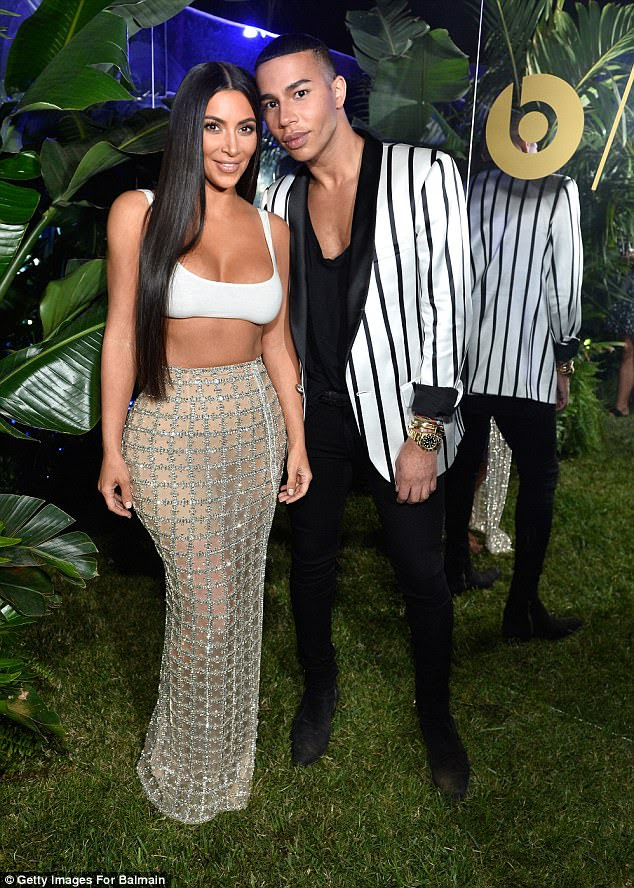 Fashion friends: Kim posed with Balmain's creative director Olivier Rousteing, who looked chic in a black and white striped blazer