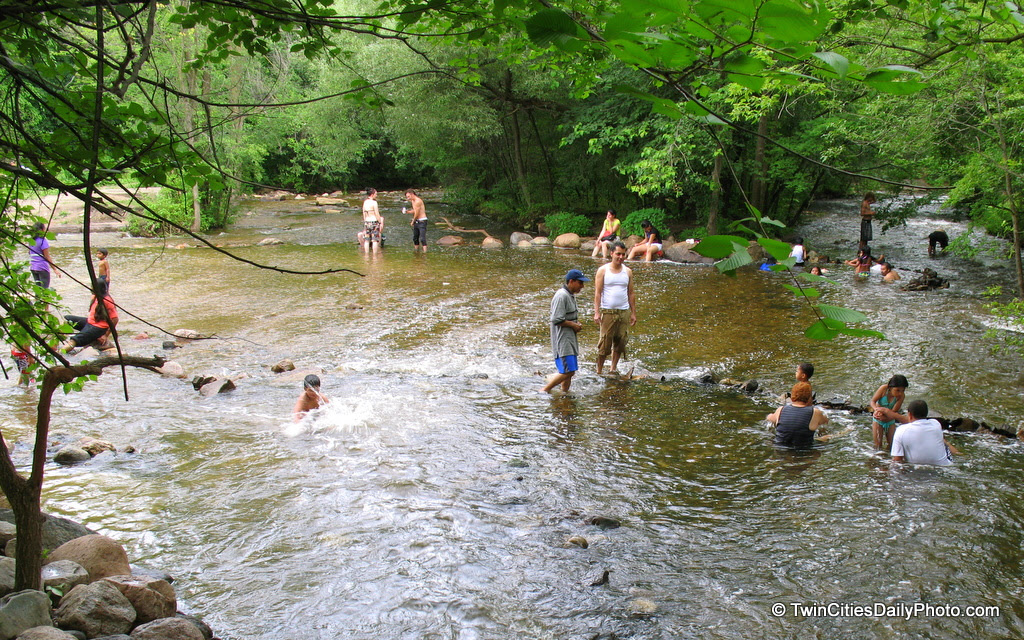 The tropical weather hit the Twin Cities on Wednesday. I found several groups of families and friends keeping cool in this clearing, downstream from the Minnehaha Falls.