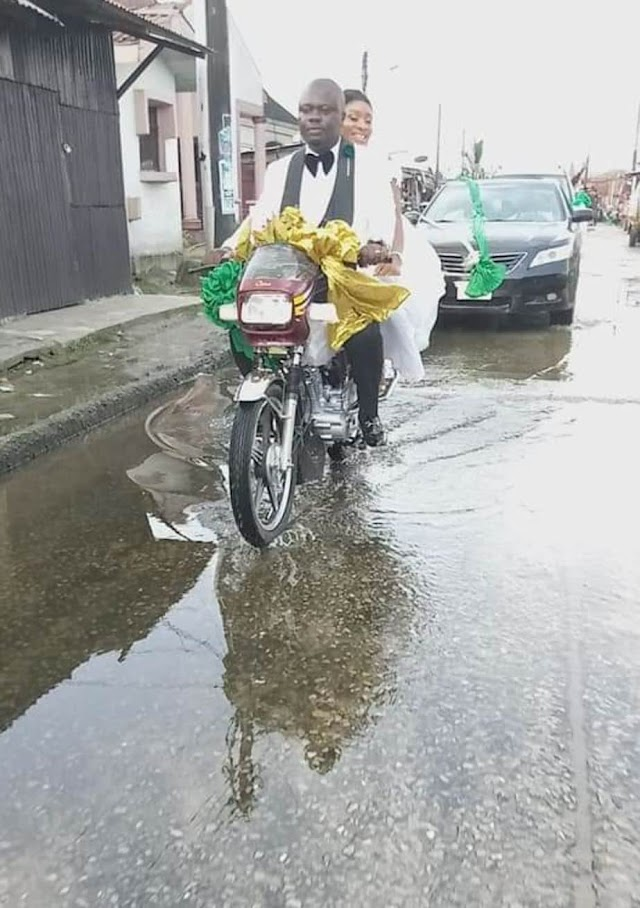Nigerian couple ride bike home after their wedding in Port Harcourt