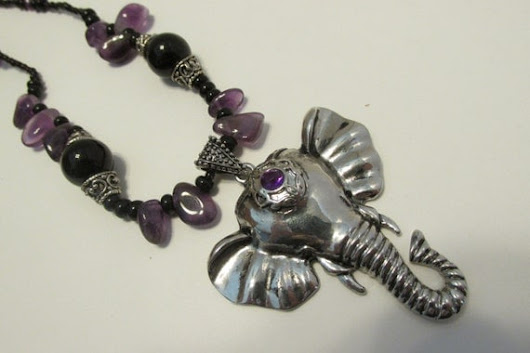 Black and purple elephant necklace $16.00