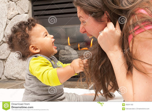 Happy Mother Baby Fire Place Stock Photo - Image: 68291182