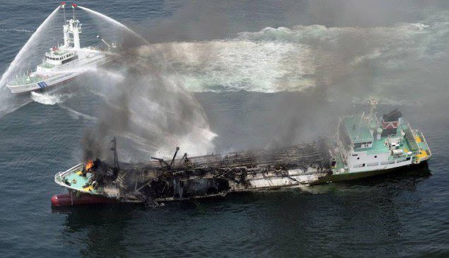 Smoke raises from the fuel tanker Shoko Maru after it exploded off the coast of Himeji, western Japan, in this photo taken by Kyodo May 29, 2014. Mandatory credit REUTERS/Kyodo