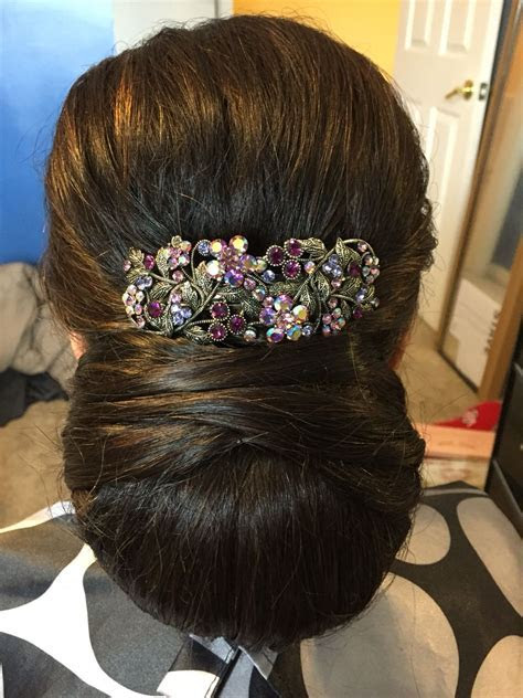 Mother of the bride hairstyle Indian hairstyle. Low bun