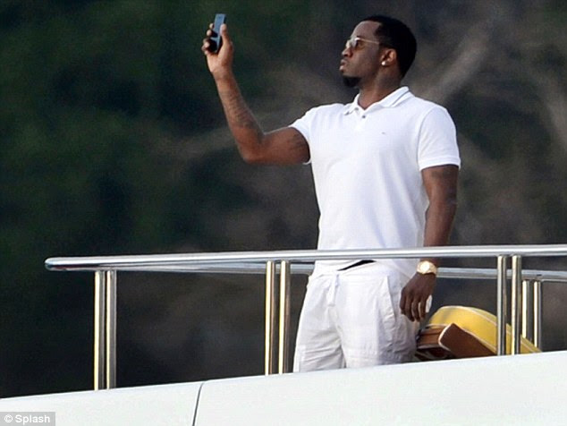 He's got the look: Diddy looked effortlessly cool dressed in head-to-toe white