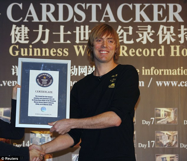 The record breaker proudly accepts  his certificate form the   Guinness Book of World Records