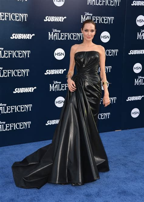 Wearing a rubberized silk Atelier Versace gown at the