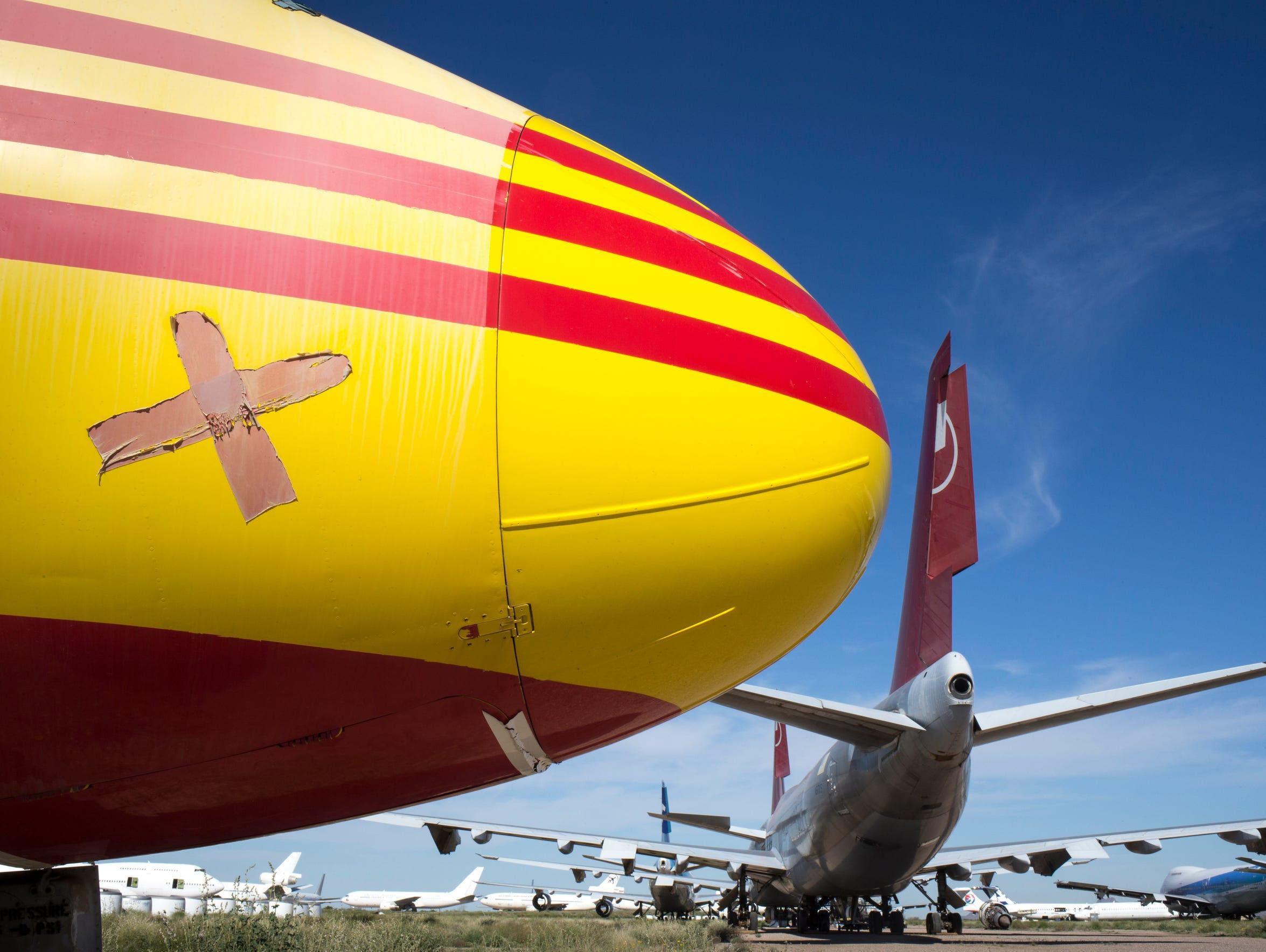 A DC-9 (yellow) sits at Pinal Airpark, Marana, Arizona.