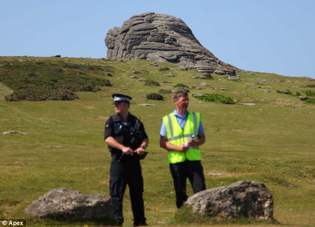Dartmoor: Police stood guard near the spot where the pair tragically plunged to their deaths