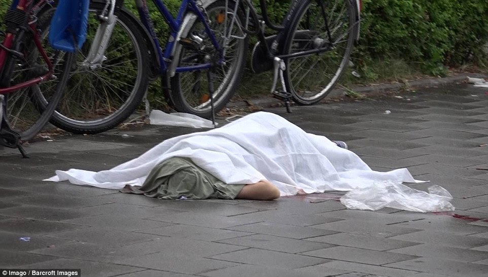 Police gave a 'cautious all clear' early this morning, more than seven hours after the attack began and brought much of the city to a standstill as all public transit systems were shut down amid a massive manhunt. Pictured is a body lying outside the mall