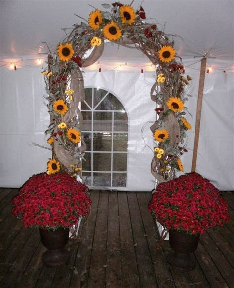 Grapevine Arch with sunflowers, mums and burlap designed