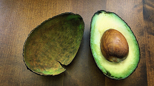 The one place on the avocado to squeeze to tell whether it's fully ripe