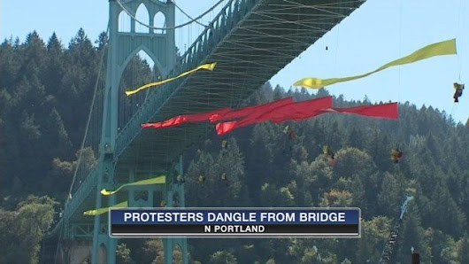 Greenpeace protesters hang off St. Johns Bridge to block ship's passage