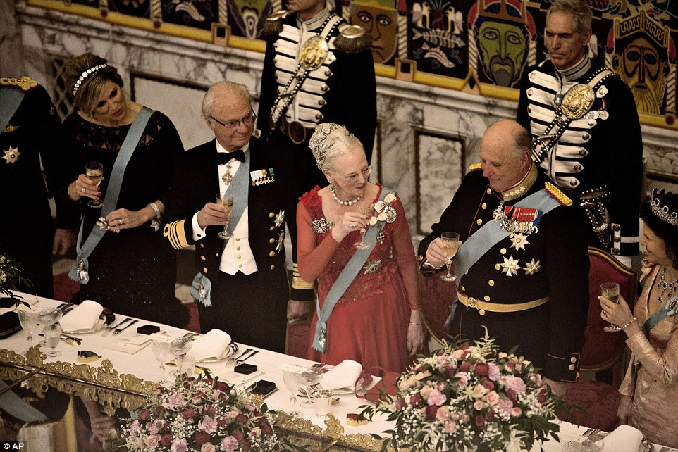Cheers! The two Scandinavian kings toast their Danish counterpart during the gala dinner