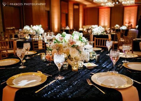 Navy and gold wedding with white and blush centerpieces