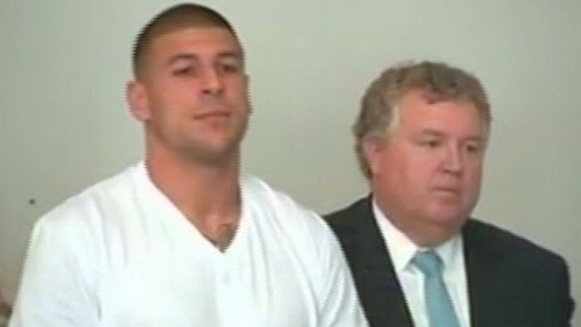 Hernandez Charged With Murder, Cut by Patriots