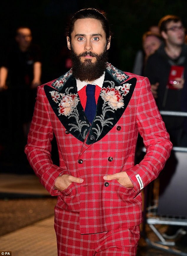 Check you out:The handsome actor, 45, was the picture of confidence as he donned a flamboyant scarlet tweed suit to accept the coveted Actor Of The Year gong