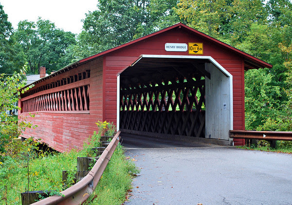 The Burt Henry Covered Bridge in Bennington is a Town Lattice design spanning the Walloomsac River.  The bridge, with a rare double truss, was originally built circa 1840 and rebuilt in 1989 by the Vermont Agency of Transportation.