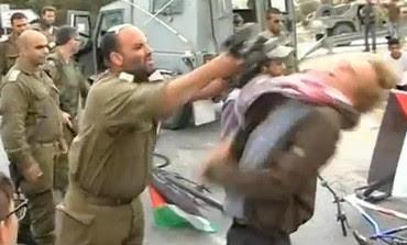 IDF officer hitting activist with M-16