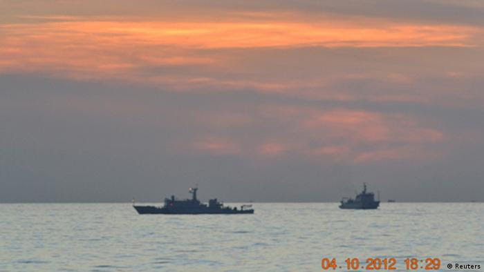 Two Chinese surveillance ships which sailed between a Philippines warship and eight Chinese fishing boats to prevent the arrest of Chinese fishermen in the Scarborough Shoal, a small group of rocky formations whose sovereignty is contested by the Philippines and China, about 124 nautical miles off the Philippine island of Luzon, are seen in the South China Sea in this April 10, 2012 file photo. China withdrew one of three ships engaged in a standoff with Philippines vessels in a disputed area of the South China Sea on April 13, 2012 as both sides pursued talks to defuse the dispute.  REUTERS/Philippine Army Handout/Files (PHILIPPINES - Tags: POLITICS MILITARY MARITIME) FOR EDITORIAL USE ONLY. NOT FOR SALE FOR MARKETING OR ADVERTISING CAMPAIGNS. THIS IMAGE HAS BEEN SUPPLIED BY A THIRD PARTY. IT IS DISTRIBUTED, EXACTLY AS RECEIVED BY REUTERS, AS A SERVICE TO CLIENTS