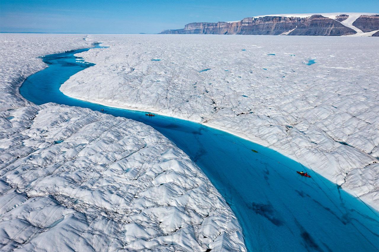 Kayaking the melt-water, Petermann Glacier.