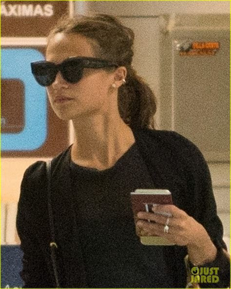 Newlyweds Alicia Vikander & Michael Fassbender Fly Out of