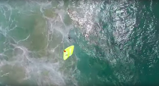 Drone saves two teenagers stuggling in ocean by dropping yellow raft