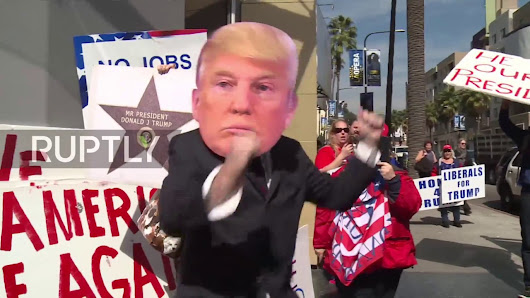 USA: Fists fly as Trump supporters rally for boycott of Oscars ceremony - YouTube