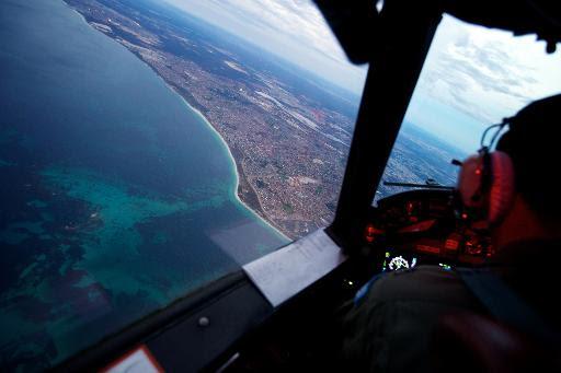 Avião australiano realizas busca pelos destroços do voo MH370, em 24 de março de 2014. Foto: Richard Wainnwright/AFP Photo