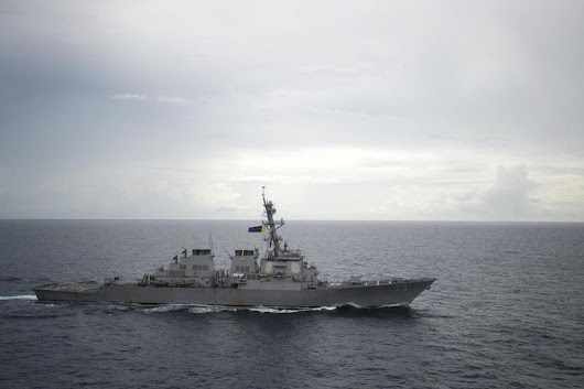 U.S. warship challenges China's claims in South China Sea - officials
