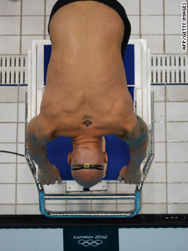 Canada's Brent Hayden takes the start of the men's 100-meter freestyle heat Tuesday.